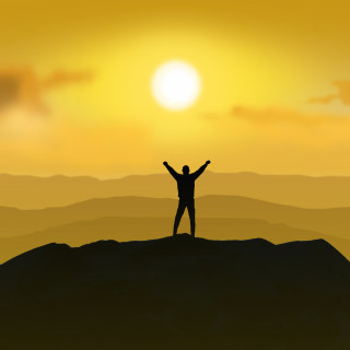 Victorious - Man standing on the top of a mountain with raising